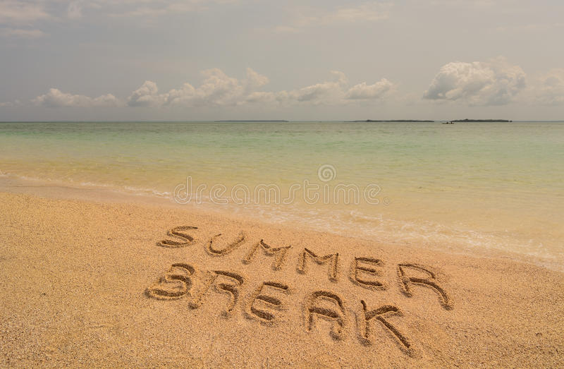 Summer break. In the photo a beach in Zanzibar in the afternoon where there is an inscription on the sand Summer Break stock photo