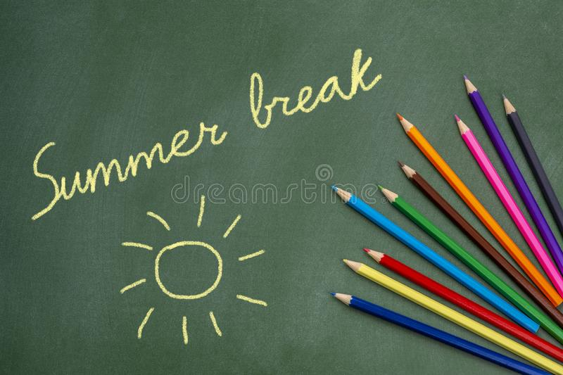 Summer Break. Text and sun drawing on green chalkborad stock photography