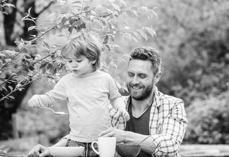 Summer breakfast. Healthy food concept. Father son eat food and have fun. Menu for children. Family enjoy homemade meal stock photos