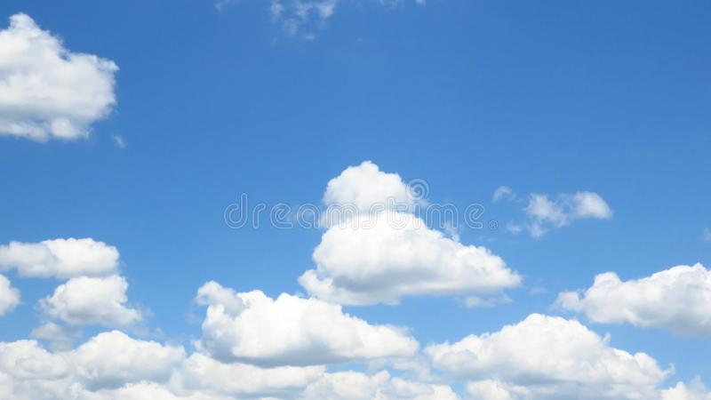 Summer bright blue sky and beautiful white fluffy clouds. Weather forecast concept. Oxygen, environment. stock images