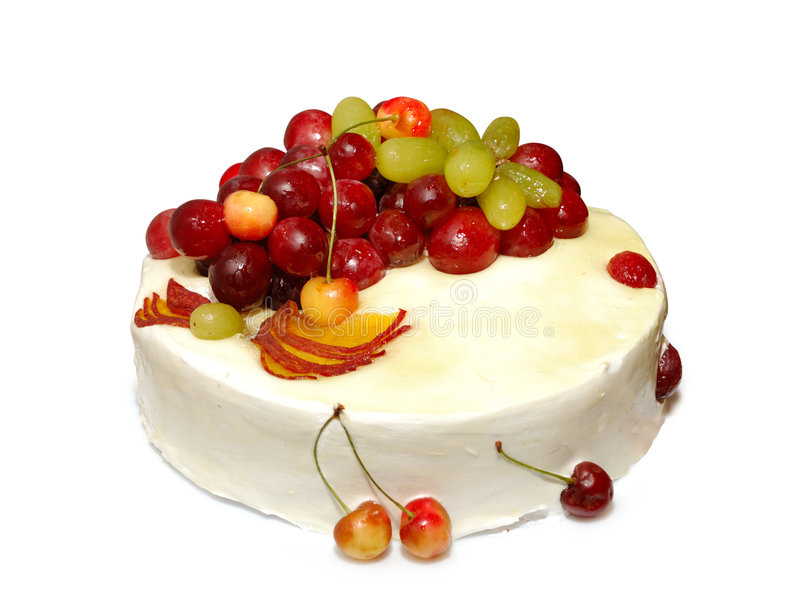 Summer cake. Appetizing colorful summer fruit white cream cake with sweet cherries isolated on white background with clipping path royalty free stock photography