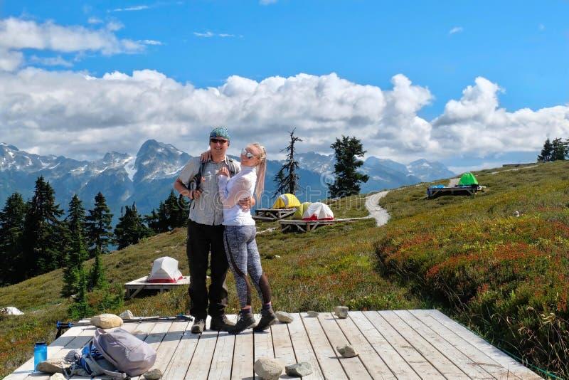 Married couple camping in Garibaldi Provincial park near Elfin Lakes. stock photo