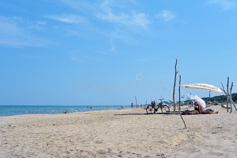 Summer camping with a tent at a lonesome wild beach Lido di Classe, Italia royalty free stock images