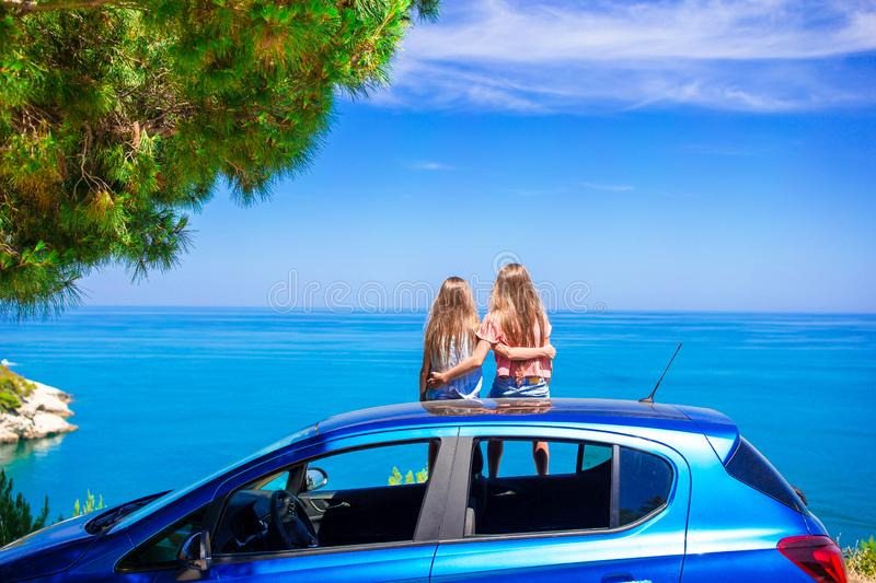 Summer car trip and young family on vacation stock photos