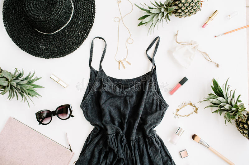 Summer casual style. Modern woman clothes and accessories collage. Dress, sunglasses, hat, purse, lipstick and pineapples. Flat lay, top view stock image