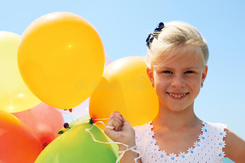 Summer, celebration, family, children and people concep. Summer holidays, celebration, family, children and people concept - happy girl with colorful balloons stock images