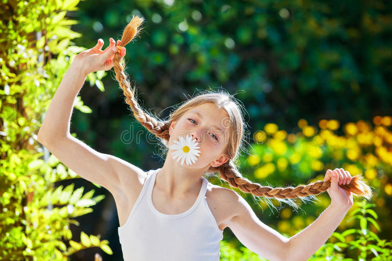 Summer child with plaits or braids. Red head, ginger summer child with plaits or braids royalty free stock images