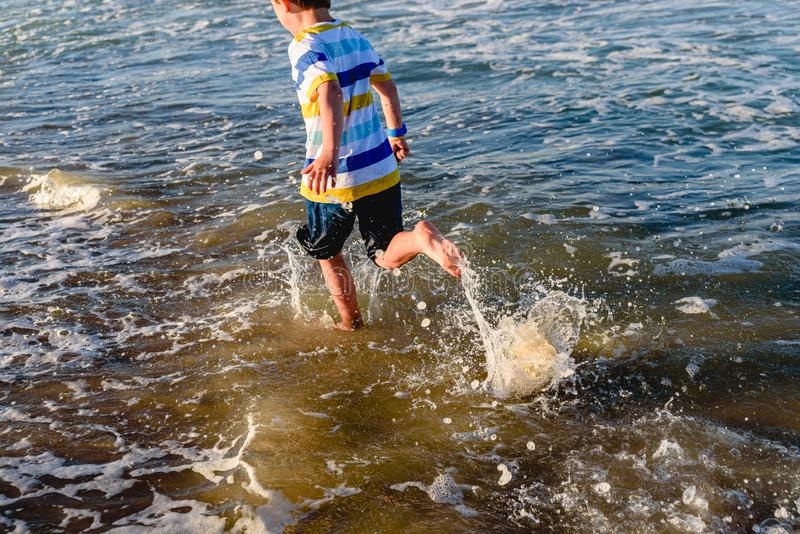 In summer children have to exercise outdoors and go out to sea to run alongside the waves.  royalty free stock photography