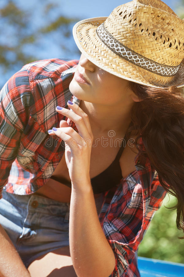 Summer chill. Portrait of a young woman chilling in the sun royalty free stock photography