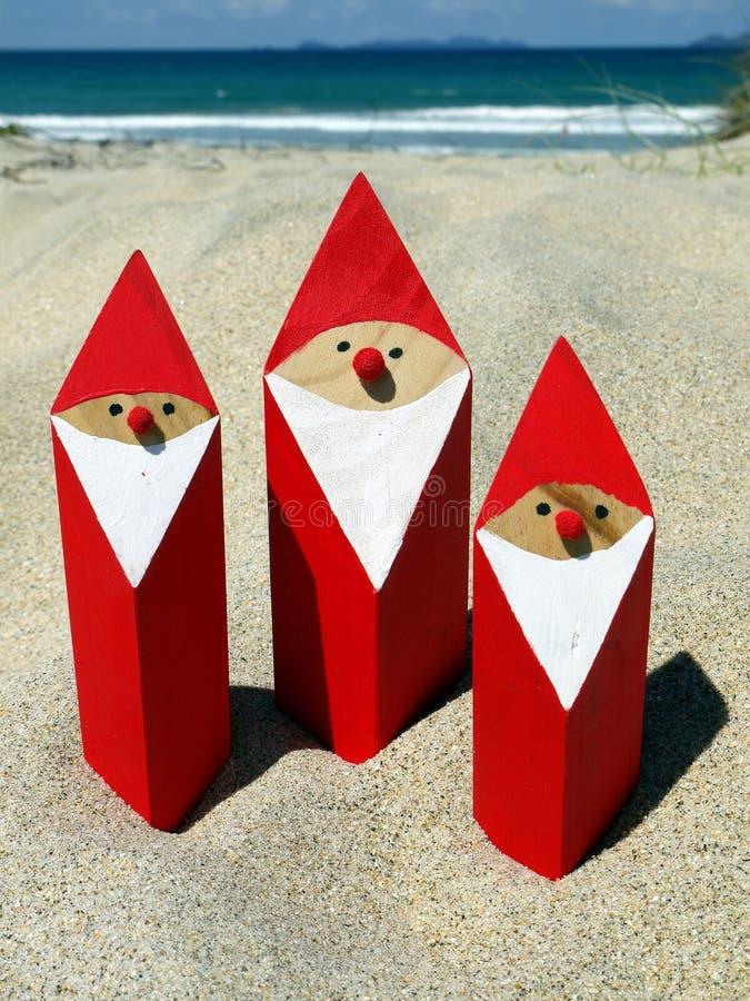 Summer Christmas: santas at beach stock photography