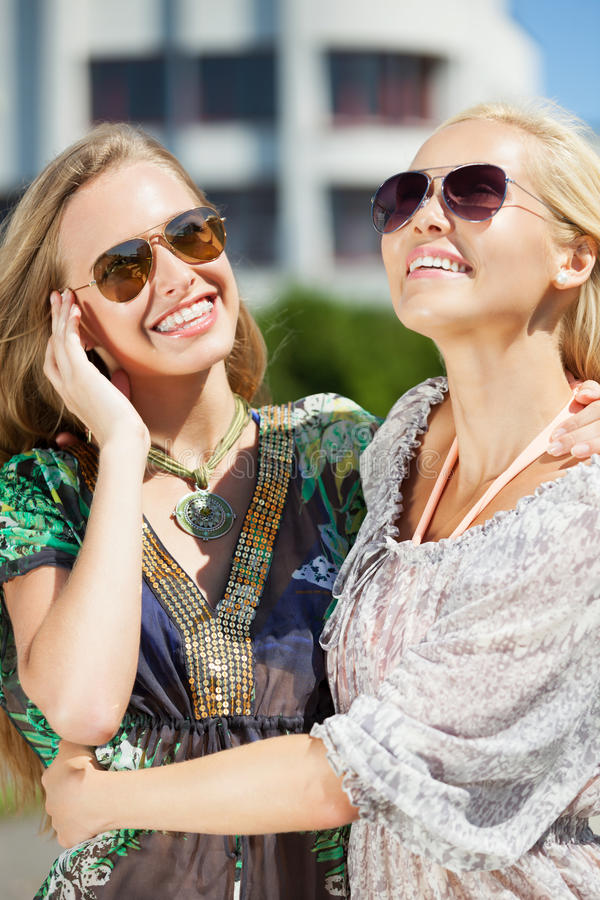 Summer city life. Two girls enjoying summer in the city royalty free stock photos