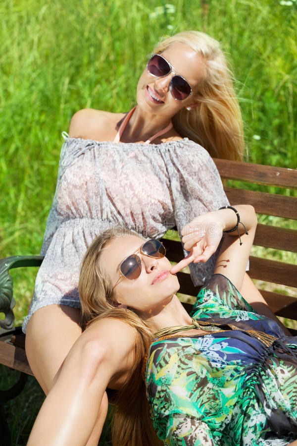 Summer city life. Two girls enjoying summer in the city stock photos
