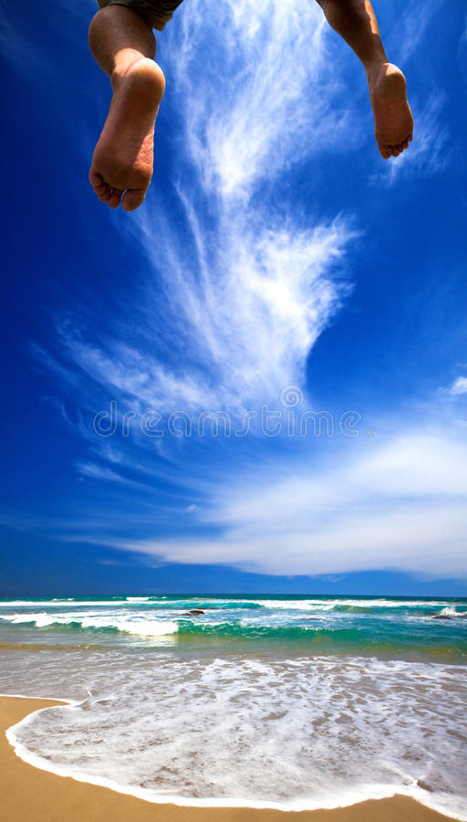 Summer cloud and jump to sea stock photo
