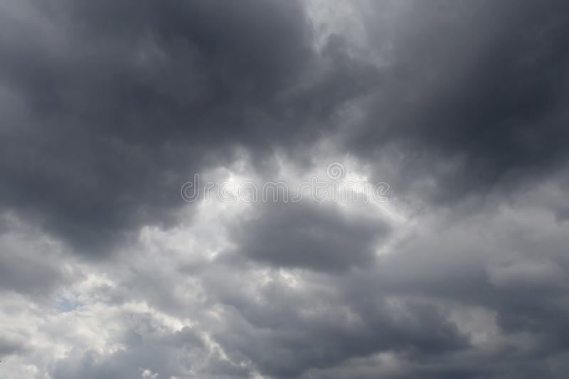 Summer. the cloud is very dark. it will rain soon. there is toning. Background, water, silhouette, texture, nature, storm, thunderstorm, gray, dramatic, sky royalty free stock image