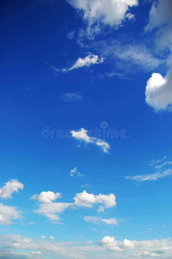Summer clouds. Big summer clouds in blue royalty free stock photos