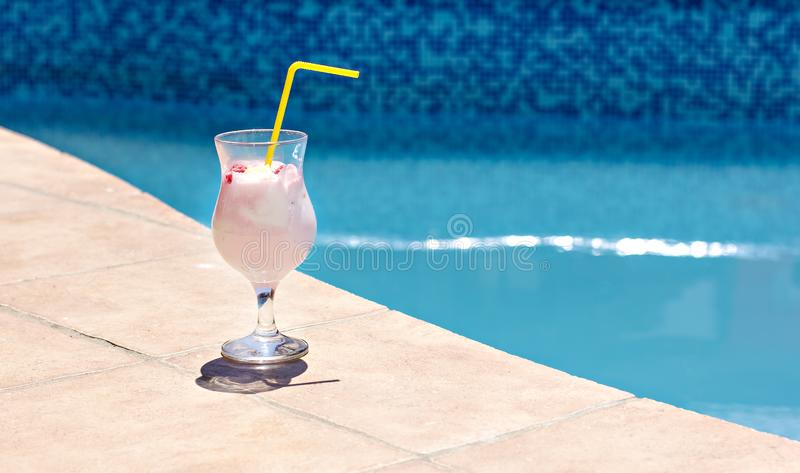 Summer cocktail on the background of the pool. Pina colada, milk cocktail, berry cocktail. royalty free stock image