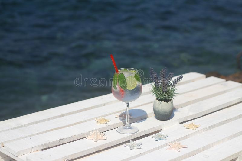 Summer cocktail on the background of the pool. Summer vacation, relaxation, royalty free stock photo