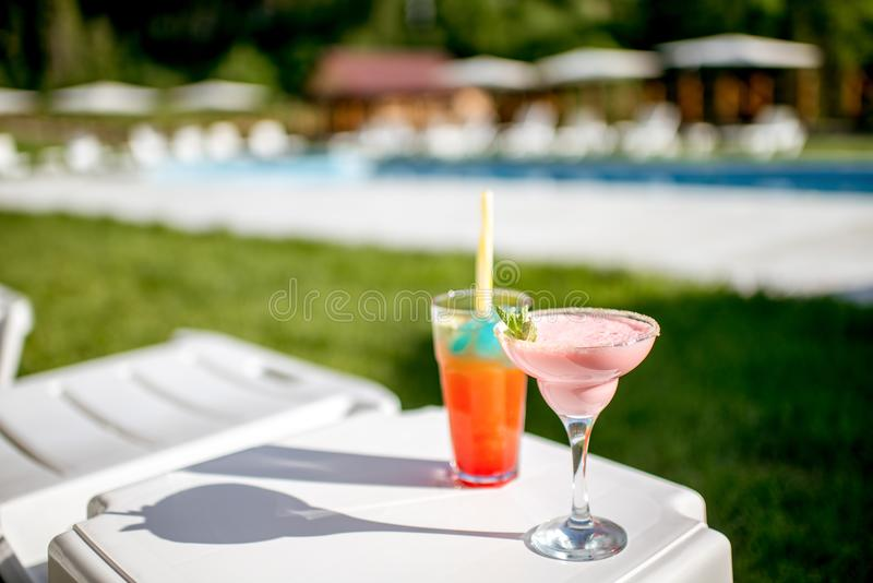Summer cocktails near the swimming pool stock image