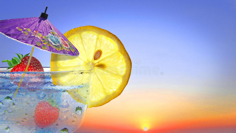 Summer cocktails. Photo of cocktail glass with summer fruits and parasol against a sunset sky ideal for own text etc stock images