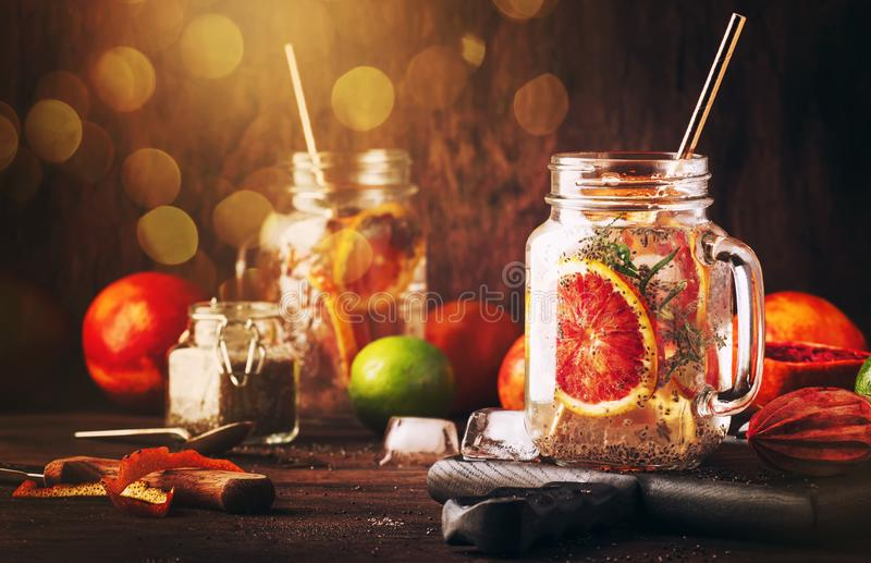 Summer cold detox drink with red orange, citrus fruit juice and chia seeds. Healthy fitness drink. Ingredients for cooking on royalty free stock photography