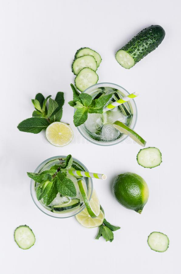 Free Summer Cold Drink With Ice Cubes, Slices Lime, Cucumber, Straw, Twigs Mint And Ingredients On White Wood Board, Top View. Stock Photography - 116771792