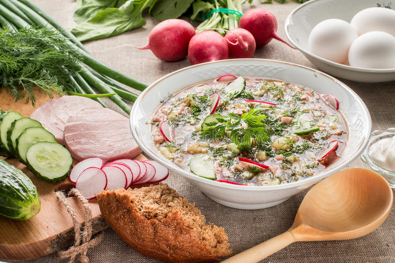 Summer cold soup with radish, cucumber, and dill. Okroshka stock photo