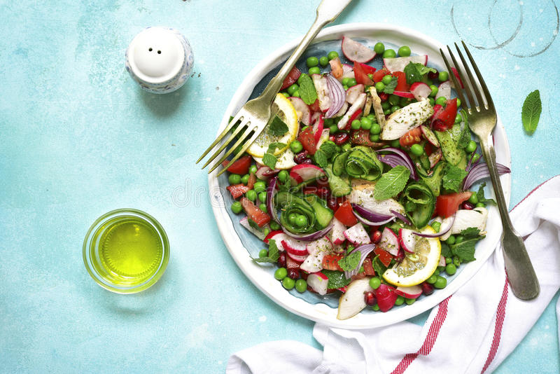 Summer colorful vegetable salad with chicken and mint.Top view. stock photo