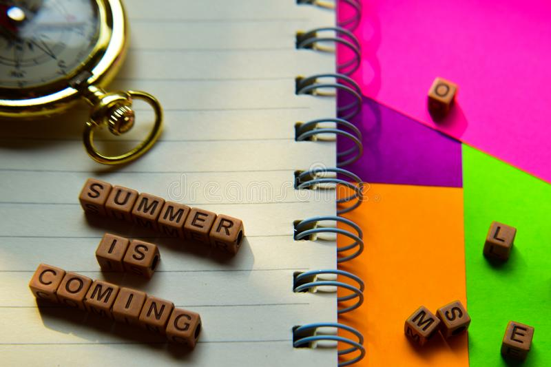 Summer is coming message written on wooden blocks. Vacation and travel concepts. Cross processed image stock photography