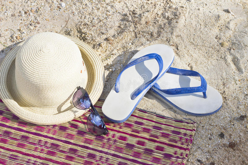 Summer concept with accessories on sand royalty free stock photography
