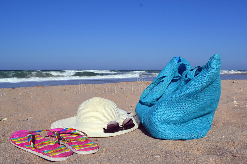 Summer concept with bag, hat, glasses and flip flops stock photo