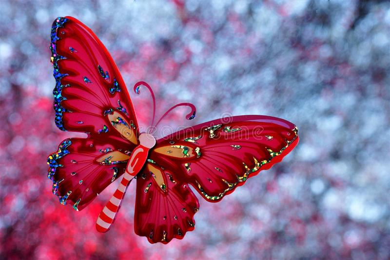 Summer the concept of a butterfly at a festive rainbow background bokeh lights. The butterfly symbolizes transformation and beauty royalty free stock images