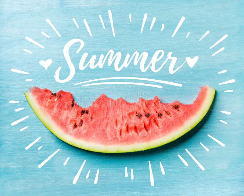 Summer concept illustration. Slice of watermelon on turquoise blue background, top view. White lettering inscription stock images