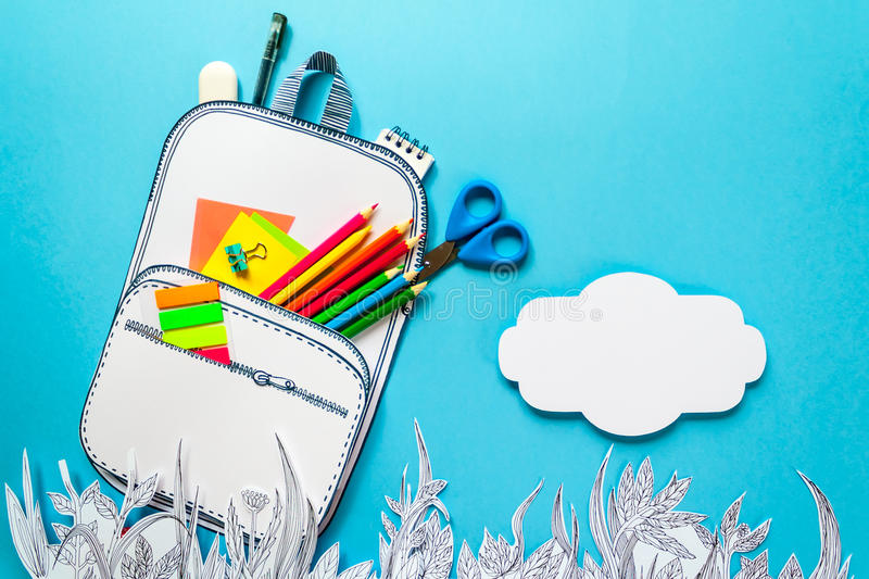 Summer concept, school backpack on graphic grass, made of paper, frame royalty free stock image
