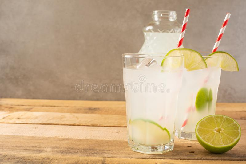 Summer cool drink, lemonade with lime and ice, two glasses with space, summer mood, refreshing drink, freshness royalty free stock photos