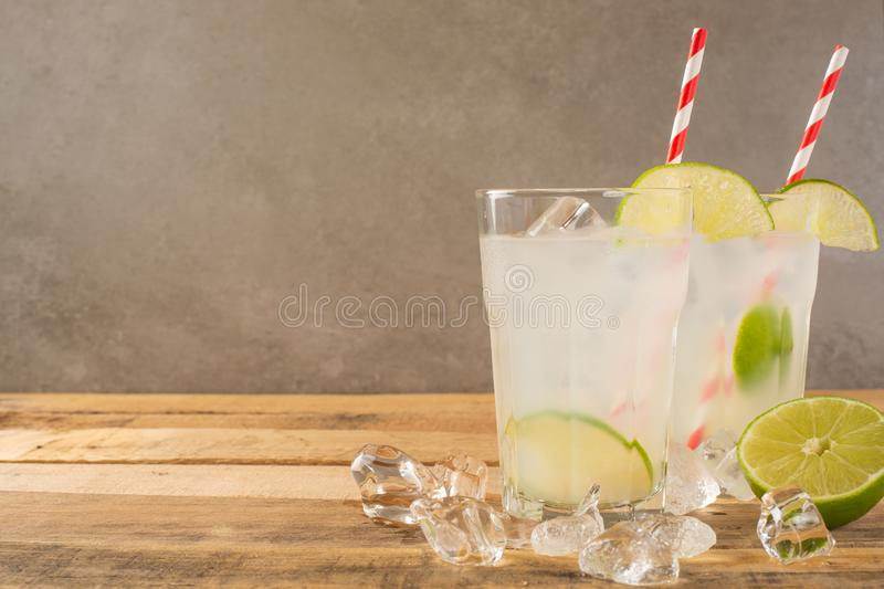 Summer cool drink, lemonade with lime and ice, two glasses with space, summer mood, refreshing drink, freshness stock photography