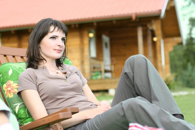 Summer cottage. Cute young girl relaxing in summer cottage stock photography