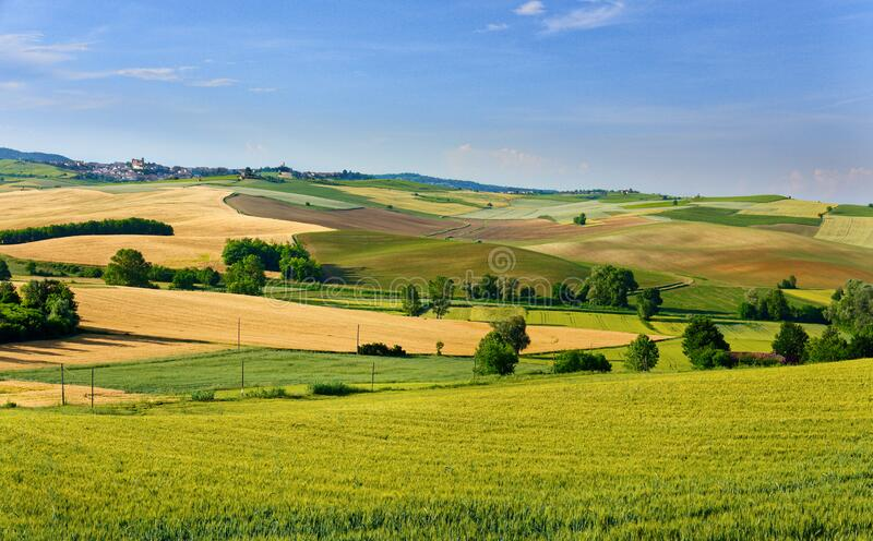 Summer country landscape in Monferrato, Piemonte, near Moncalvo, fields, hills and clouds royalty free stock photos