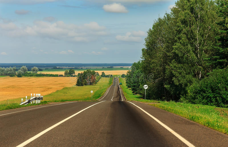 Summer country road with trees beside. Rural up hill, vintage , environment road.Nature road stock images