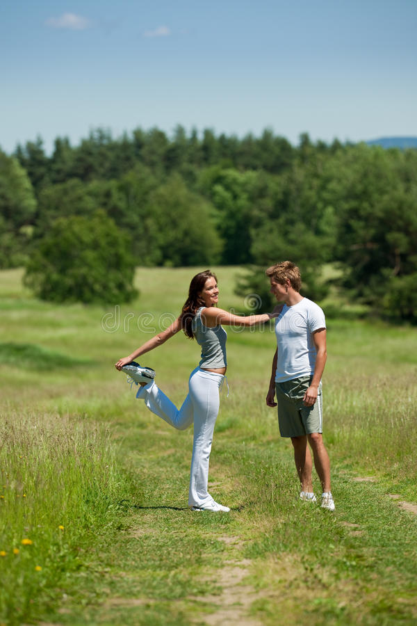 Download Summer - Couple Stretching In A Meadow Royalty Free Stock Images - Image: 9985729