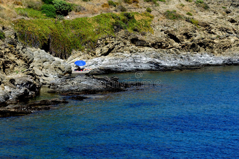 Summer: a cove cliff of cape of the Crosses in Spain with blue sea stock images