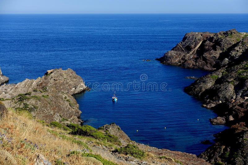 Summer: a cove cliff of cape of the Crosses in Spain with blue sea stock photo