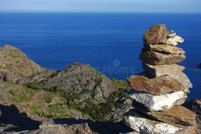 Summer: a cove cliff of cape of the Crosses in Spain with blue sea. Cape of the Crosses Cap de Creus in English Capo delle Croci, in Spanish Cabo de Creus is a stock photo