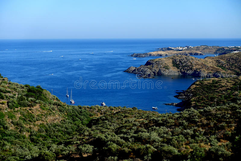 Summer: a cove cliff of cape of the Crosses in Spain with blue sea. Cape of the Crosses Cap de Creus in English Capo delle Croci, in Spanish Cabo de Creus is a royalty free stock photos
