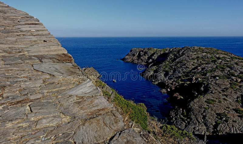 Summer: a cove cliff of cape of the Crosses in Spain with blue sea. Cape de Creus in English cape of the Crosses, in Spanish Cabo de Creus is a leader in stock image