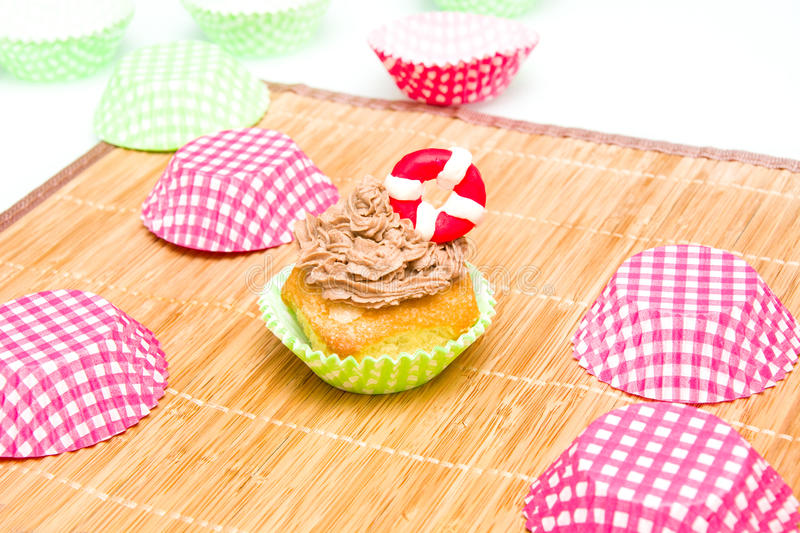 Summer cupcake with lifeguard float. In the kitchen stock image