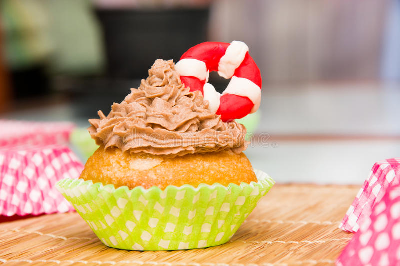 Summer cupcake with lifeguard float. In the kitchen royalty free stock images