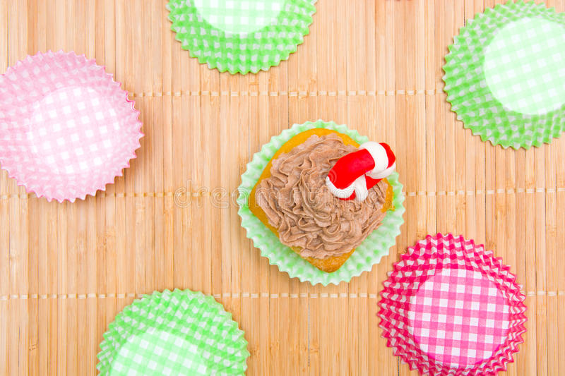 Summer cupcake with lifeguard float. In the kitchen stock photo