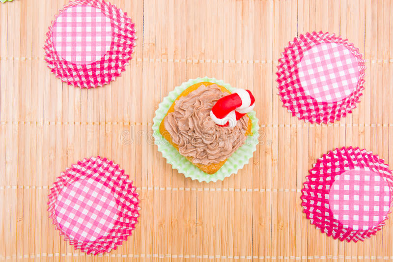 Summer cupcake with lifeguard float. In the kitchen royalty free stock photo