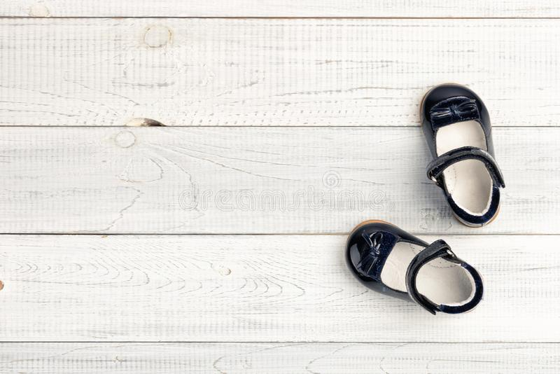Summer darkly blue Baby girl shoes on wooden background. Top view trendy leather sandal, flat lay. Copy space for your text stock photo
