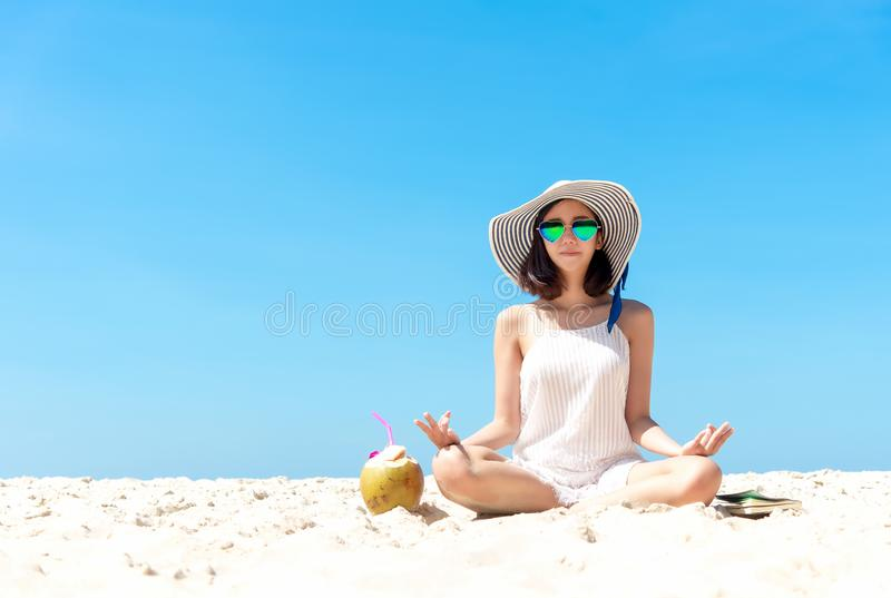 Summer day. Asian lifestyle women yoga, relaxing and happy on the beach. stock photo